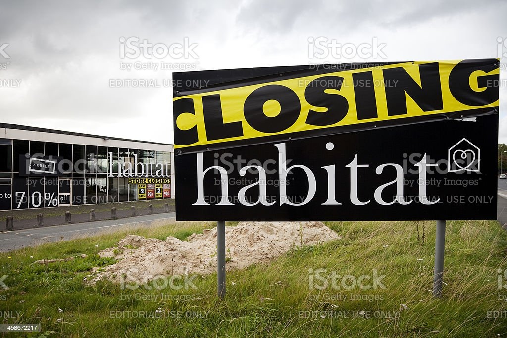 Store closing, storm clouds, recession royalty-free stock photo