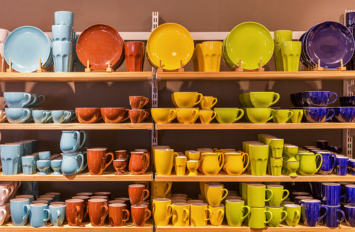 Store display of colorful tableware on the shelves.