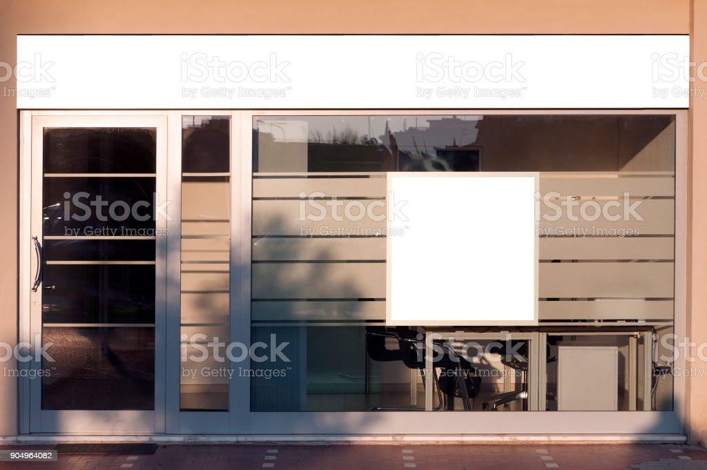 Store front with blank spaces for signboard and advertising stock photo