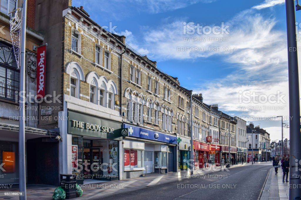 Store fronts on high street in Wimbledon, South London. stock photo