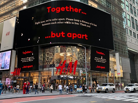Manhattan New York City, New York United States - August 27 2021: H&M clothing store near Times Square with red logo trademark.