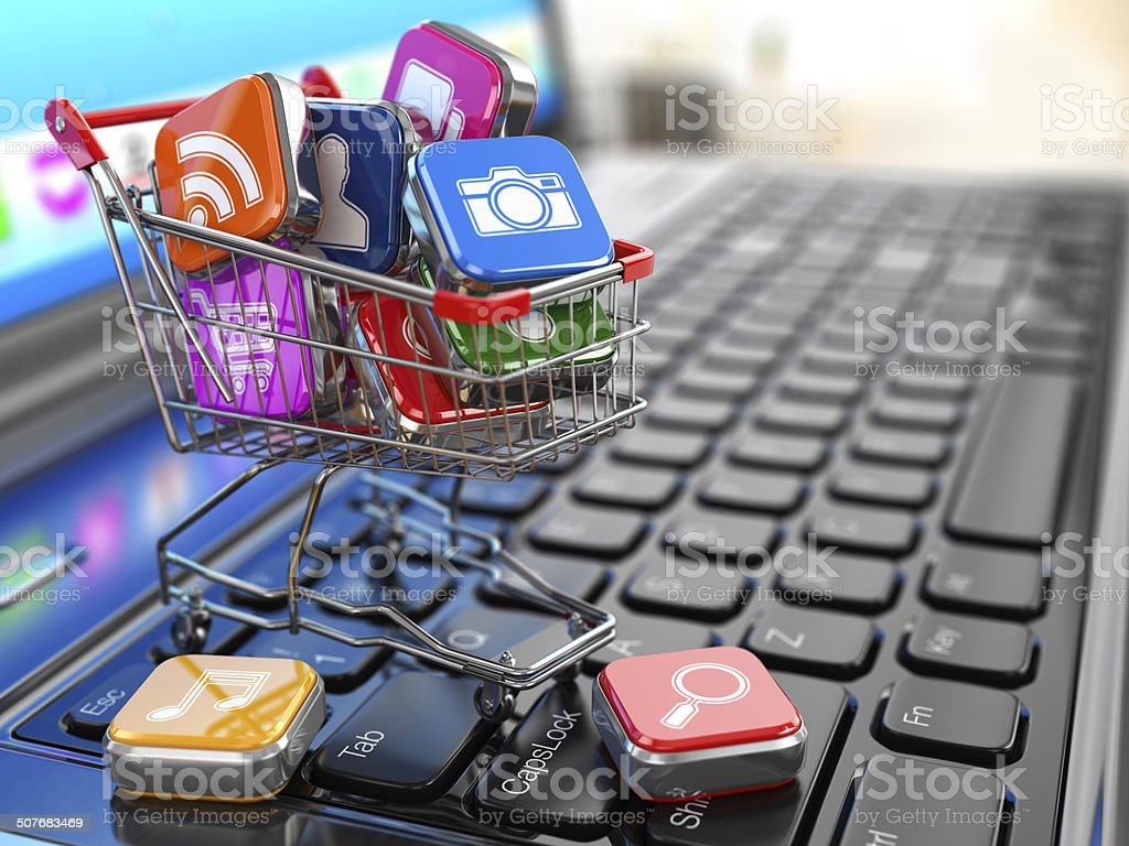 Store Of Laptop Software Apps Icons In Shopping Cart Stock Photo