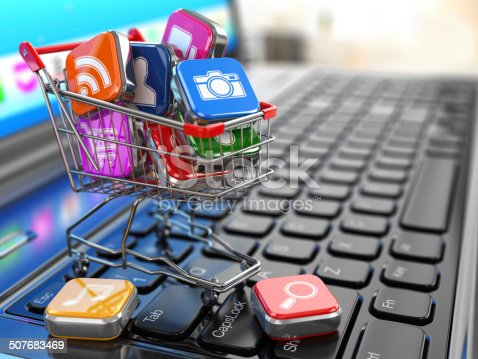 istock Store of laptop software. Apps icons in shopping cart. 507683469