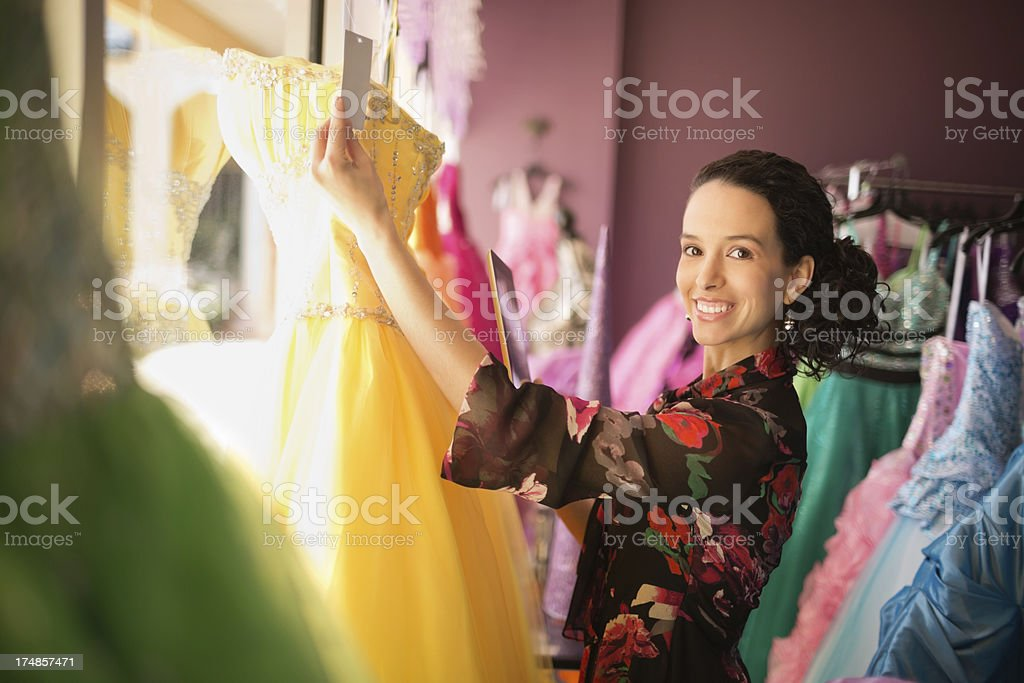 Store Owner With Digital Tablet Holding Price Tag royalty-free stock photo