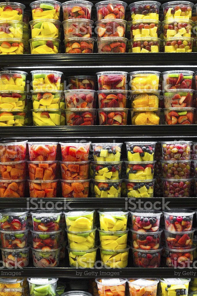 Store refrigerator aisle with fruit on shelves stock photo