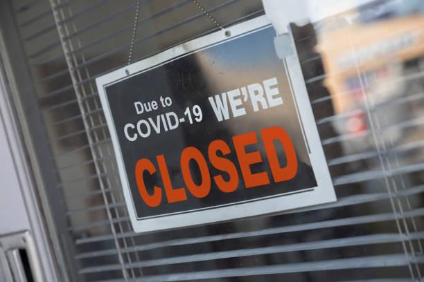 Store Temporarily Closed sign due to coronavirus stock photo