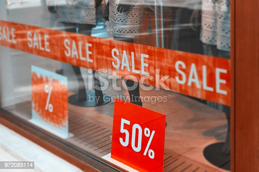 store window at sale with 50%.red banner on the window.
