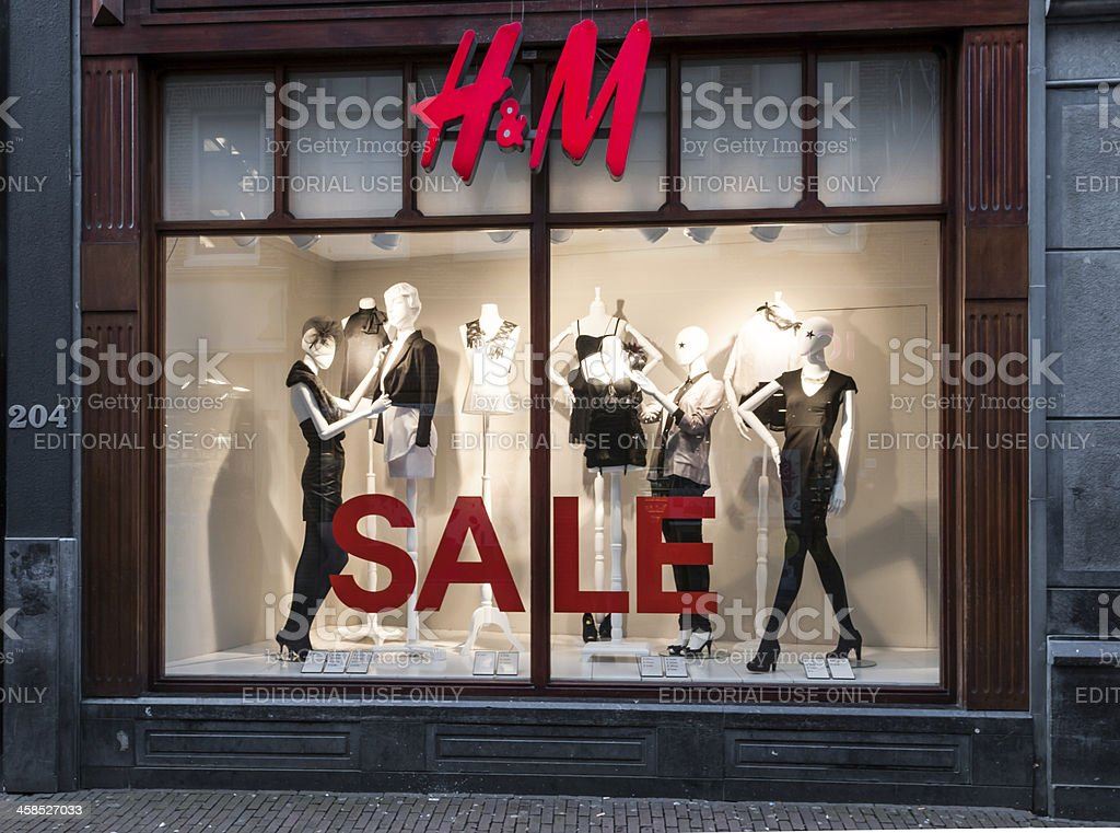 H&M store window shopping in Amsterdam, The Netherlands stock photo