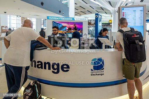945598452 istock photo Storefront to a Currency Exchange facility at Sydney Kingsford-Smith International Airport 1254991112