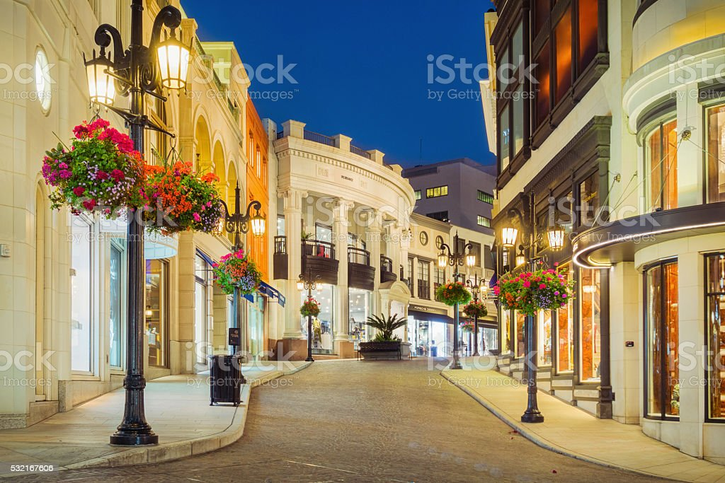 Stores on Rodeo Drive in Beverly Hills Los Angeles California Photo of Rodeo Drive with illuminated stores in Beverly Hills, Los Angeles, California, USA at twilight blue hour. Beverly Hills - California Stock Photo