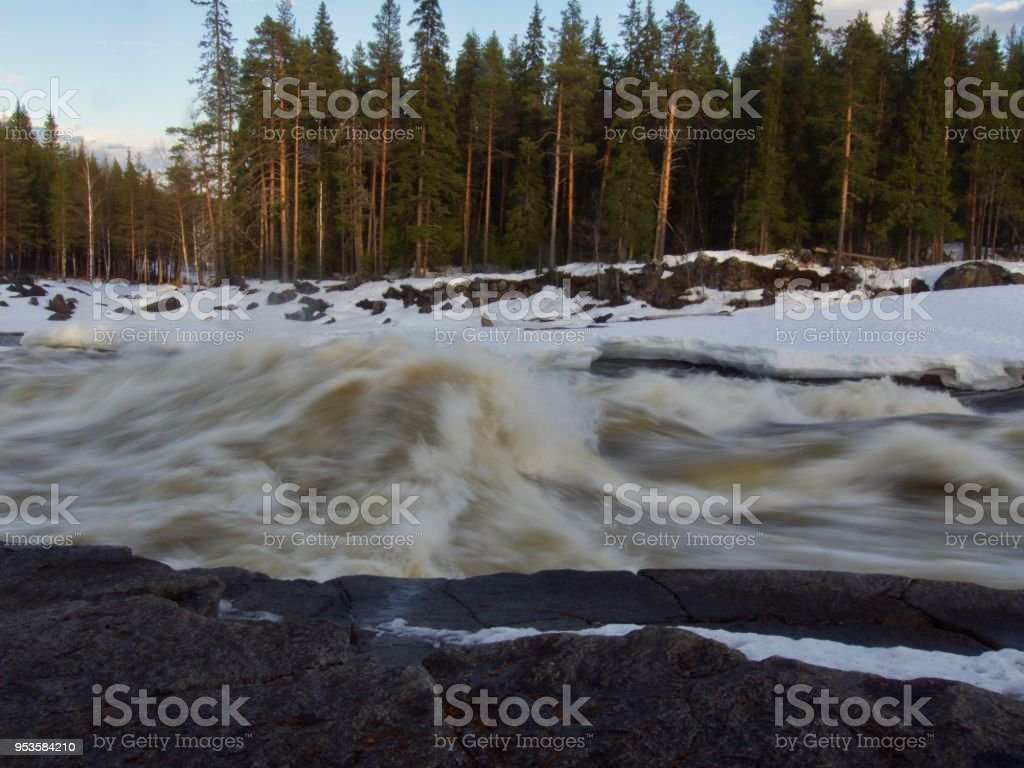 Storforsen waterfall in North of Sweden is a large white water stock photo