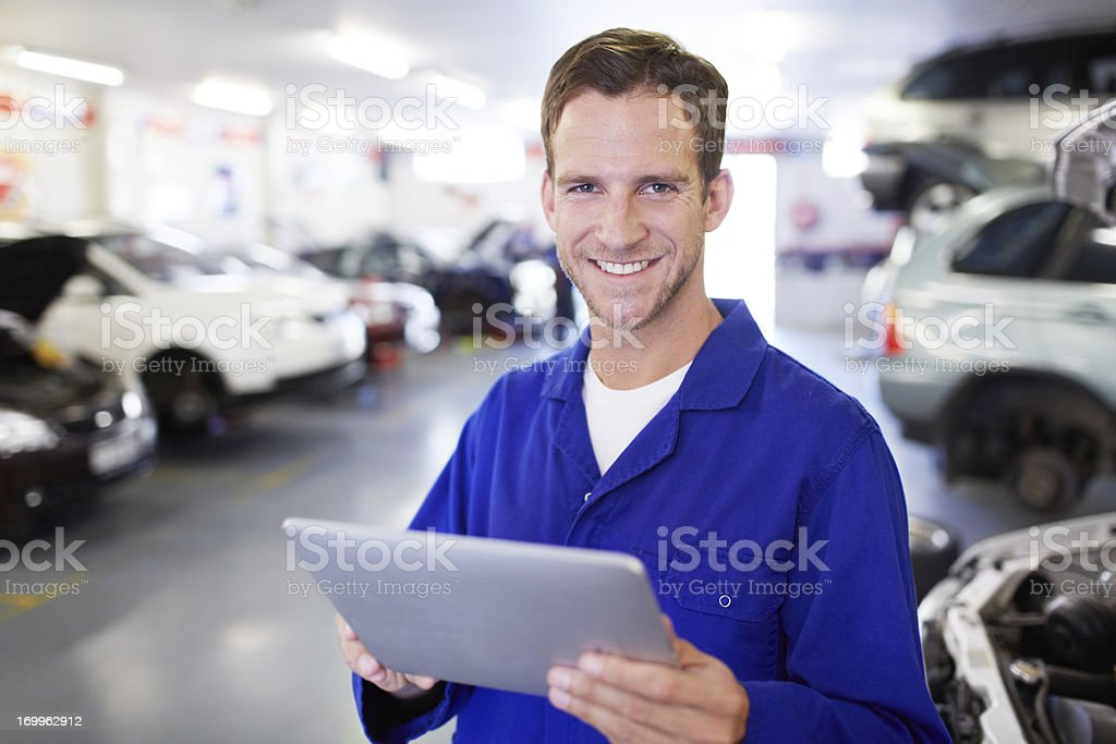 Storing the auto info on his tablet royalty-free stock photo