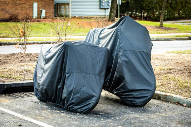 Storing two motorcycles outside under cover for protection stock photo