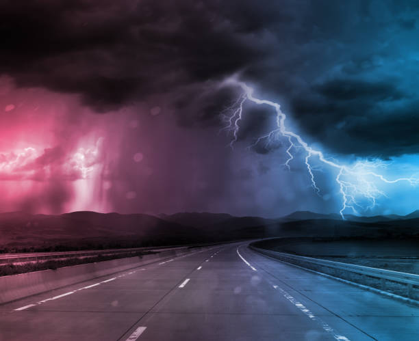 storm and thunder on road - extreme weather stock pictures, royalty-free photos & images