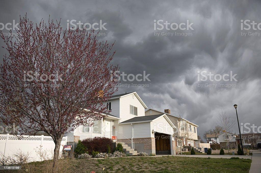 A storm approaching a neighborhood street stock photo