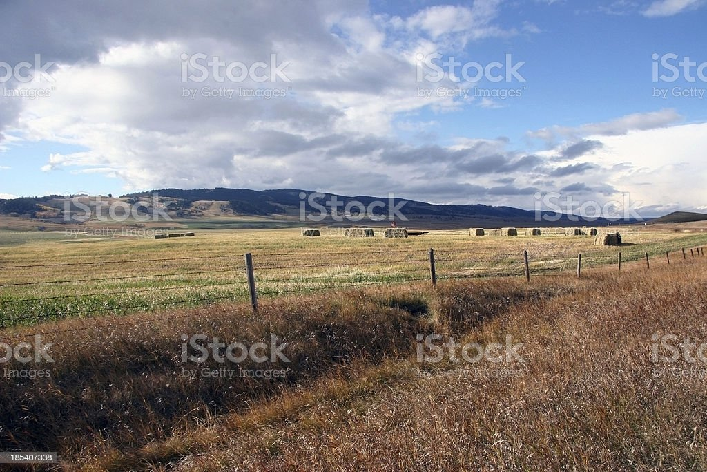 Storm Approaching Alberta Farmland and Foothills royalty-free stock photo