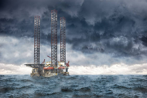 storm at sea - construction platform stock pictures, royalty-free photos & images