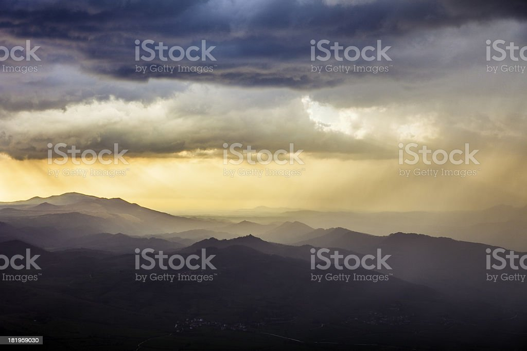 Storm at sunset as seen from a hilltop royalty-free stock photo