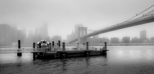 Storm Brewing over Brooklyn Brooklyn Bridge from Brooklyn Bridge Park / DUMBO deathly stock pictures, royalty-free photos & images