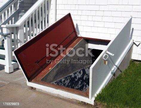 Open storm cellar door. Horizontal.