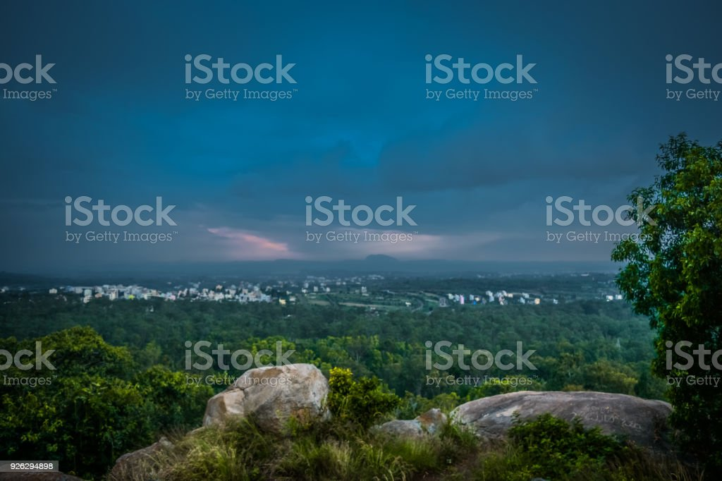 Storm Cloud Over City At Evening stock photo