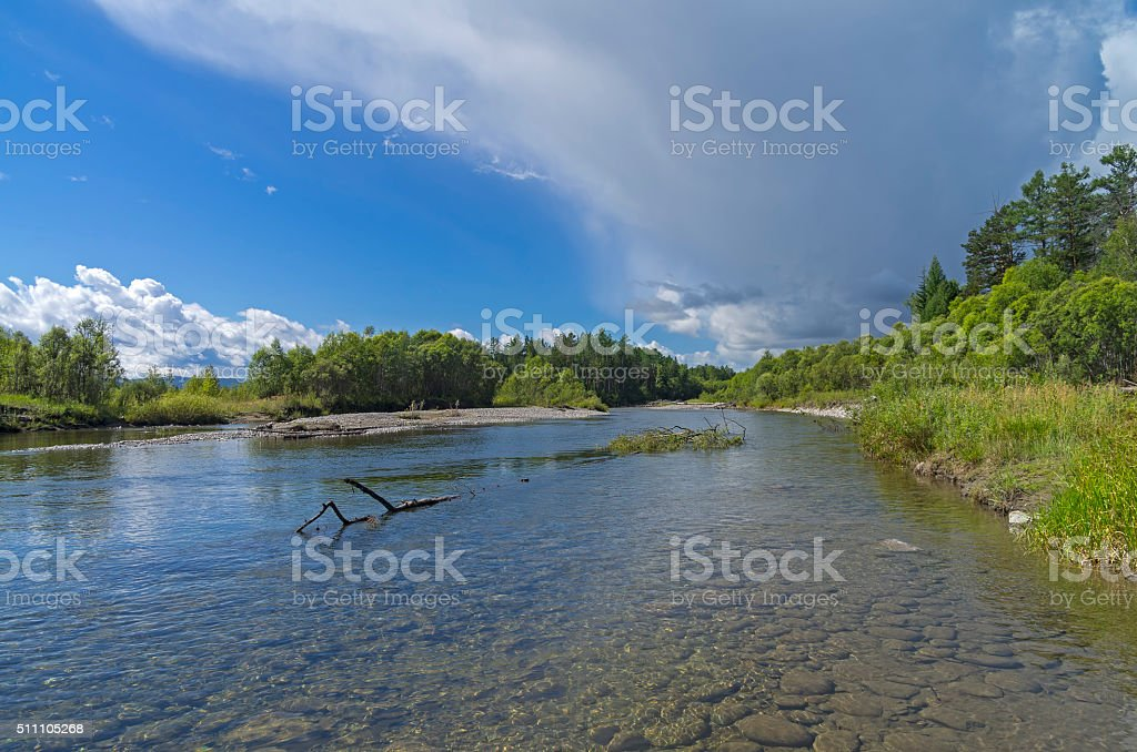 Storm cloud over the river. stock photo