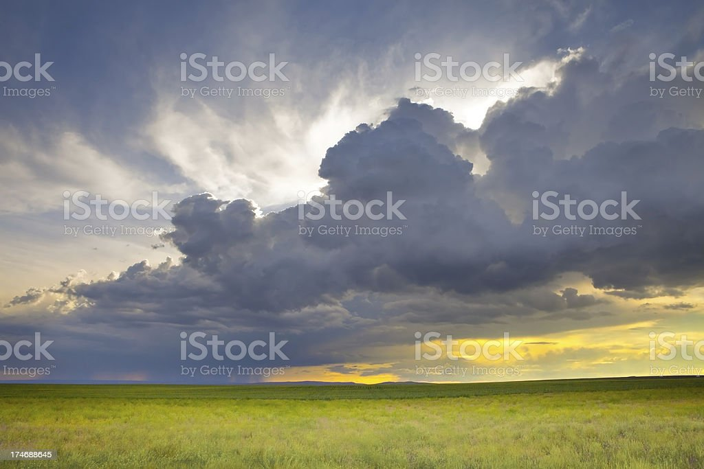 Storm Cloud & Sunset Over Green Fields royalty-free stock photo