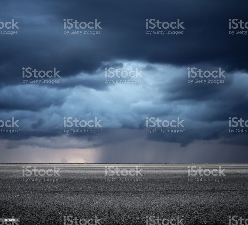 Storm clouds above asphalt road, side view stock photo