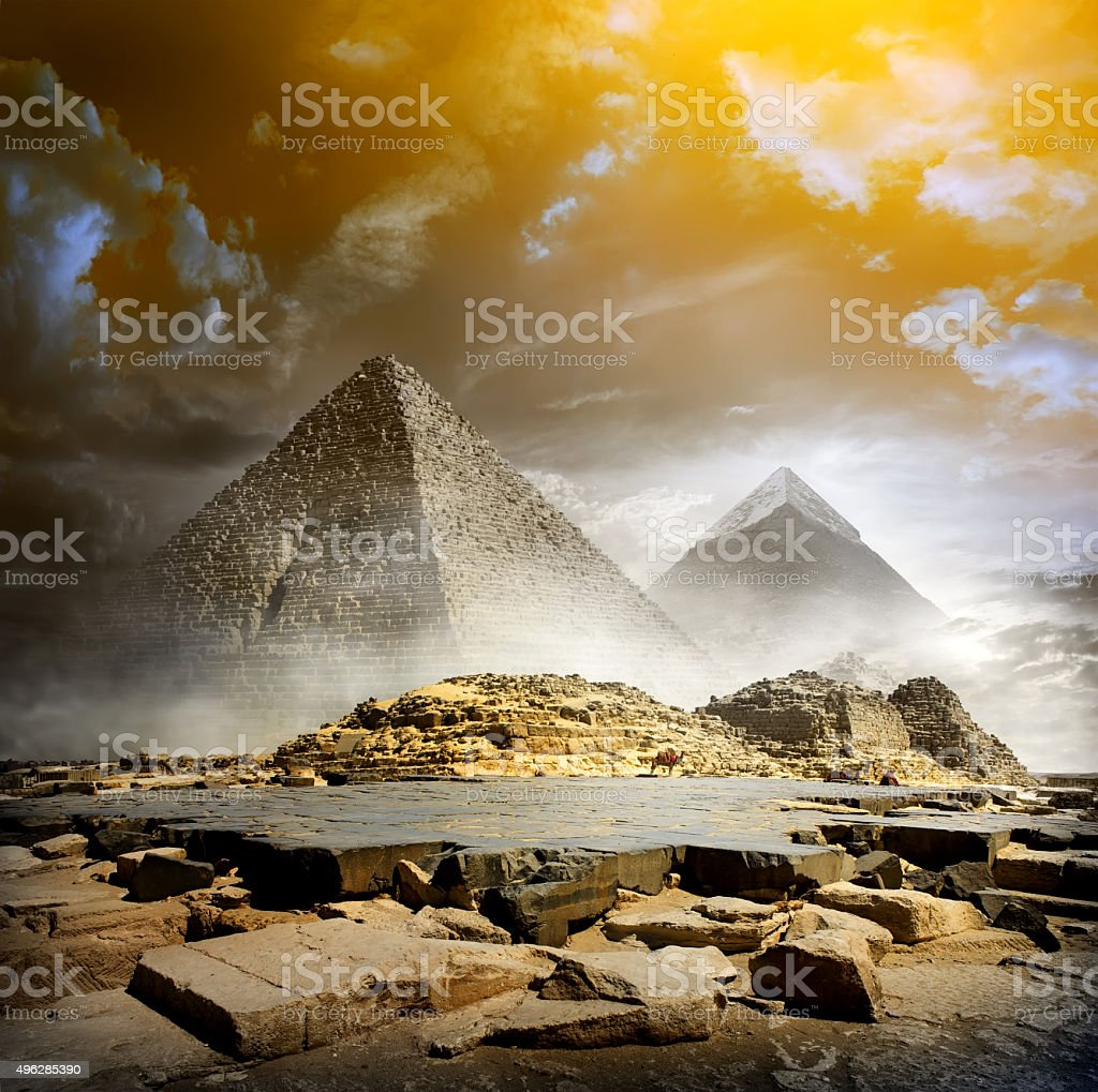 Storm clouds and pyramids stock photo