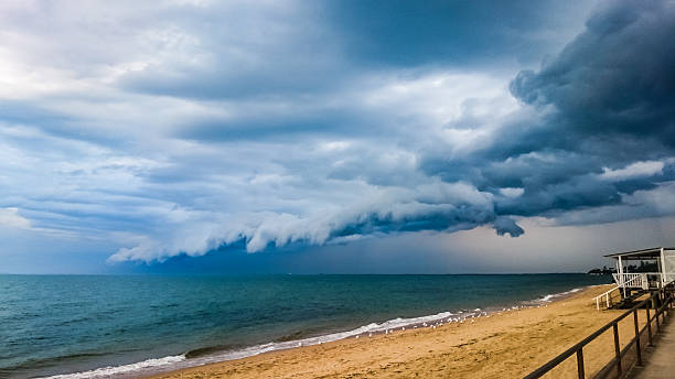 Storm clouds at beach stock photo