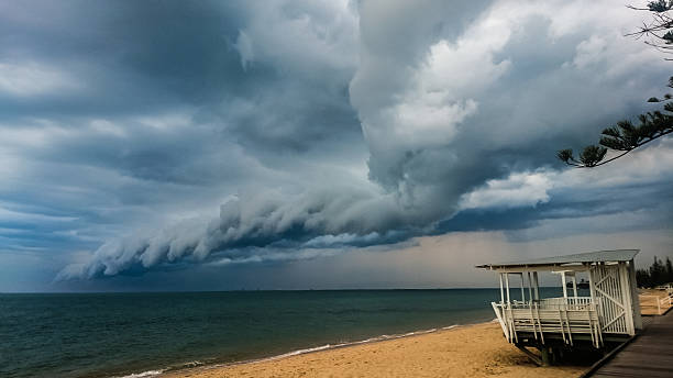Storm clouds at beach with lookout stock photo