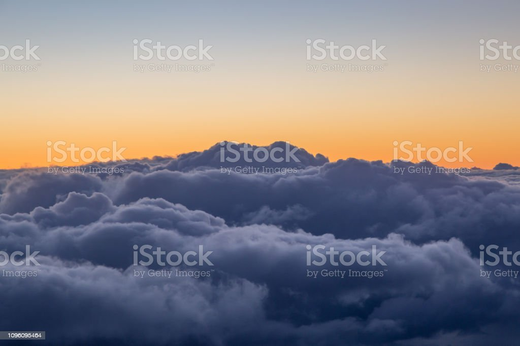 Storm Clouds at Sunset, Viewed from an Airplane Window stock photo