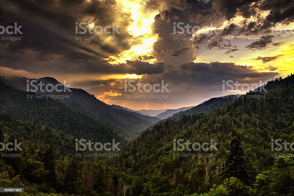 Storm Clouds Clearing at Sunset stock photo