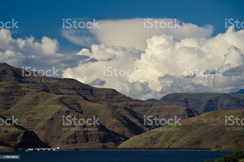 Storm Clouds Forming Above Brownlee Dam in Hells Canyon stock photo