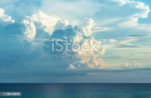 Incoming thunderstorm forming over ocean at sunset. Panhandle in Florida.