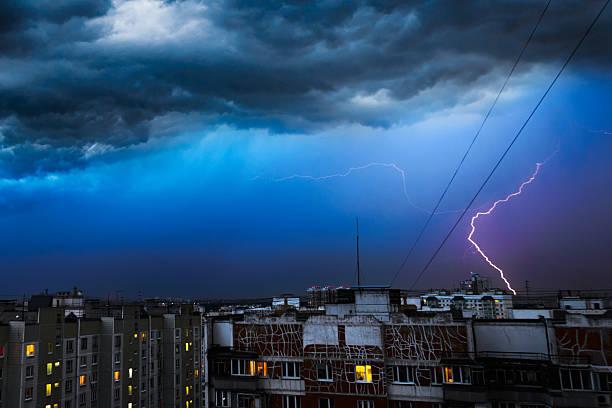 storm clouds, heavy rain. thunderstorm and lightning over the city. - greve imagens e fotografias de stock