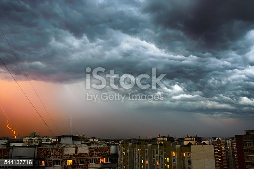 503731700 istock photo Storm clouds, heavy rain. Thunderstorm and lightning over the city. 544137716