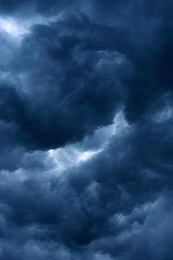 Blue storm clouds on a dark summer day.