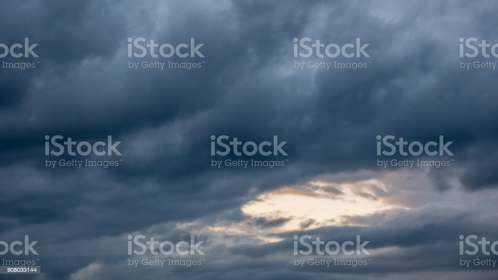Storm Clouds in the Sky with Clear Patch in the Center stock photo