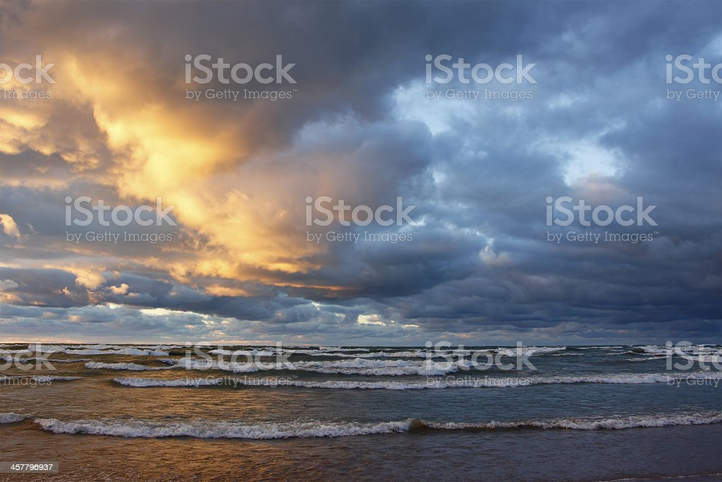 Storm Clouds Over a Beach at Sunset stock photo