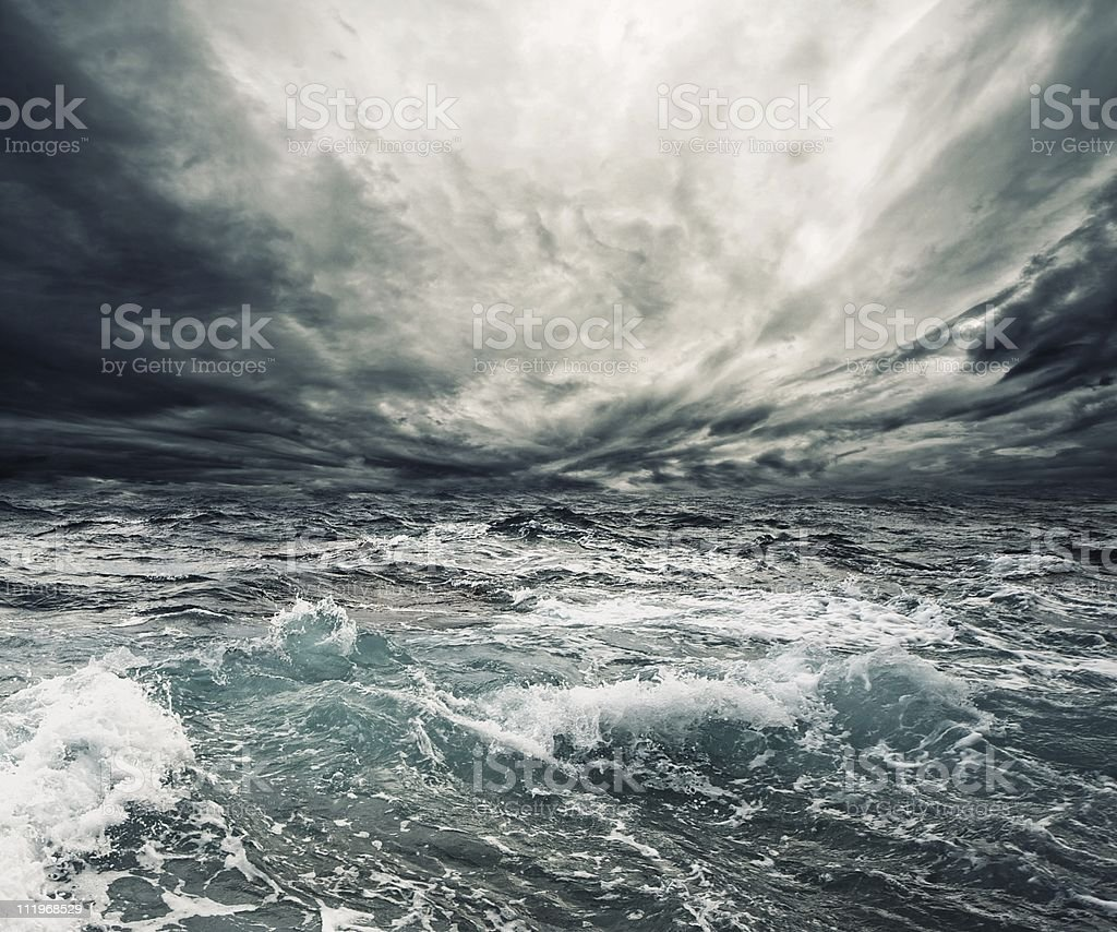 Storm clouds over a churning ocean stock photo
