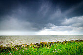 Storm clouds over the Ketelmeer lake during springtime in Flevoland, The Netherlands