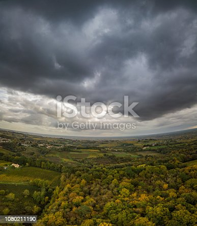 Storm clouds over Bordeaux vineyards, Gironde, France