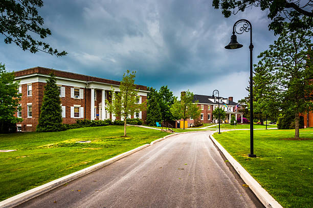 Storm clouds over building and road at Gettysburg College, Penns stock photo