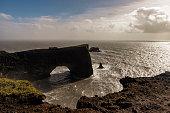 istock Storm clouds over Dyrholaey black basalt sand beach 1298569642