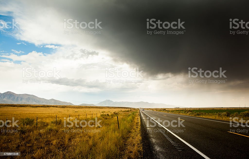 Storm clouds over Idaho road stock photo