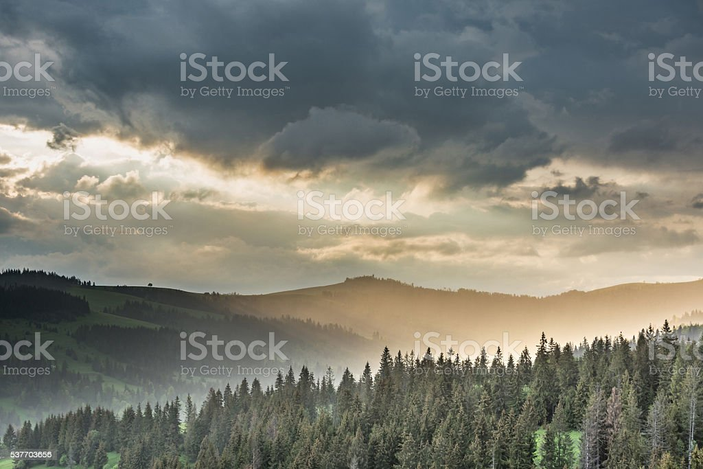 Storm clouds over mountains and the forest stock photo