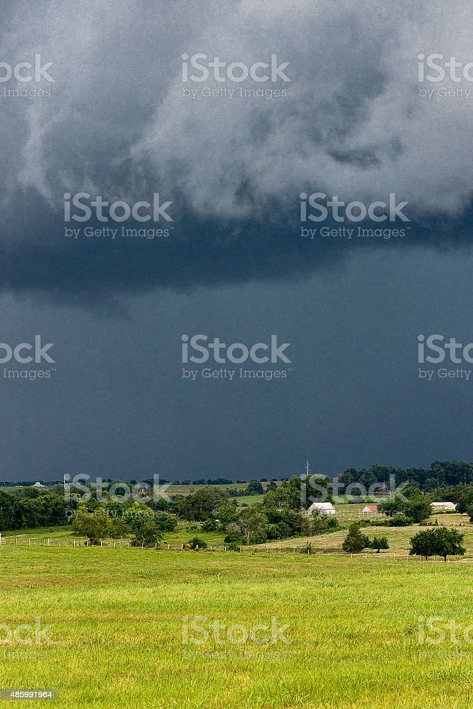 Storm clouds over ranch land in Texas stock photo