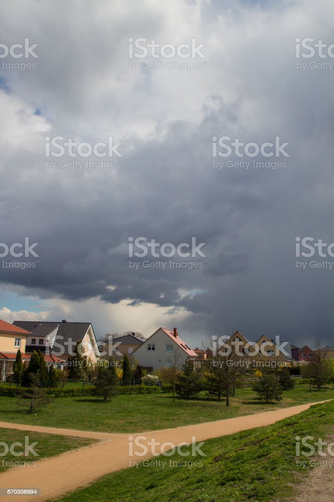 Storm clouds over suburban houses stock photo