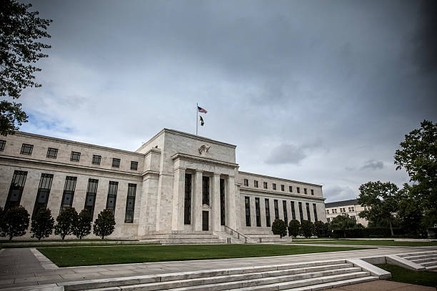 Storm clouds over the Federal Reserve cloudy, overcast day over the Federal Reserve. monetary policy stock pictures, royalty-free photos & images
